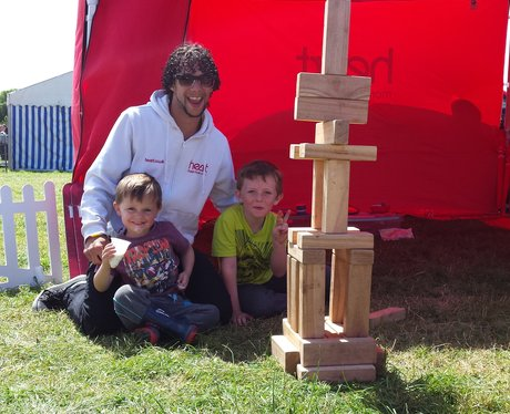 Alex with two boys playing Jenga