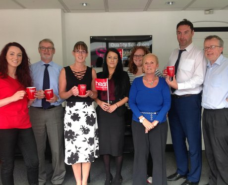 Gang of solicitors with mugs