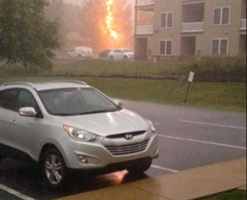 Lightening hitting a car during a storm
