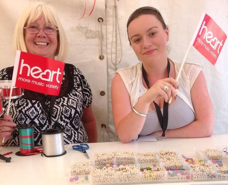 Two volunteers with Heart flags