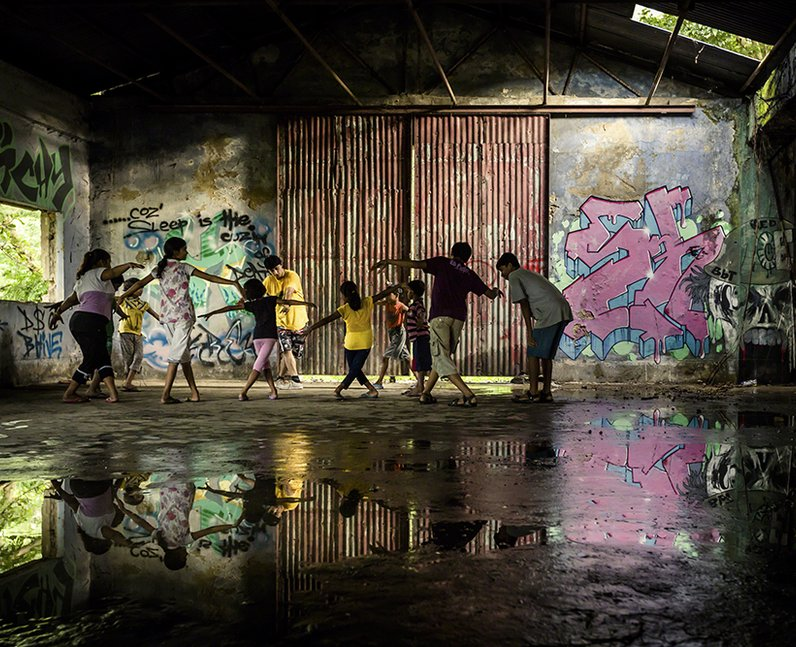 People dancing in a warehouse