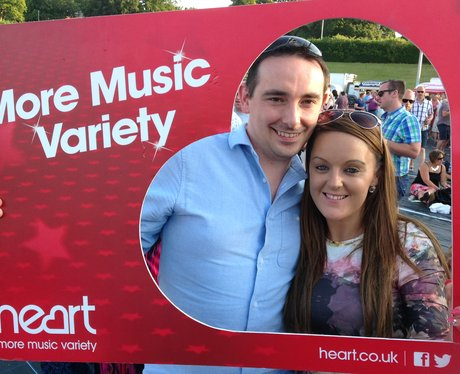listeners posing with frame at Tom Jones gig
