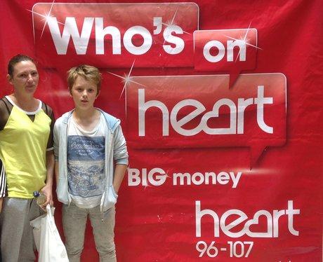 Listeners stood next to branding