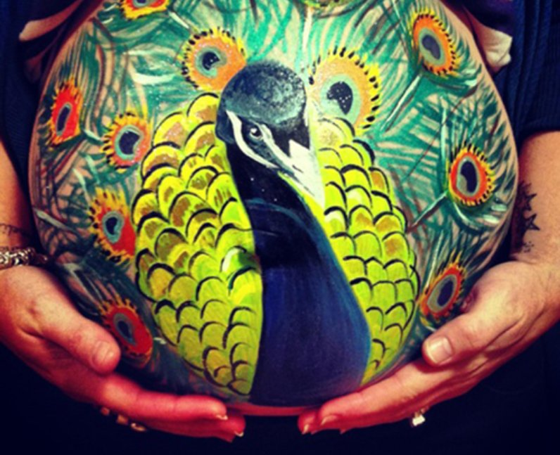 Peacock painted baby bump