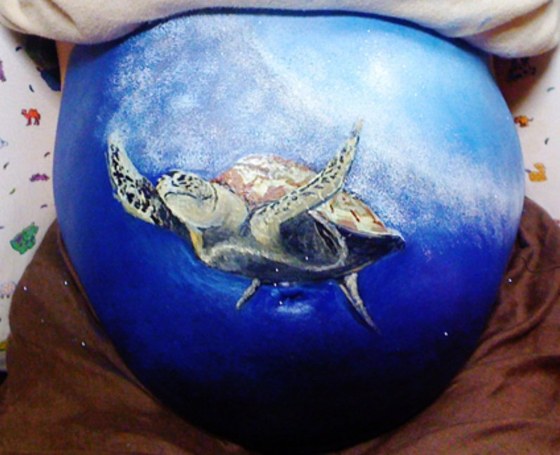 Turtle painted baby bump