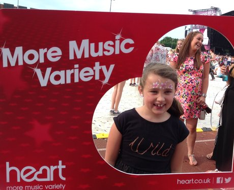 People posing with frame at Jessie J gig