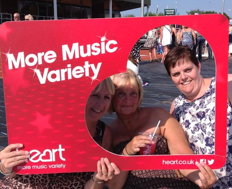 Listeners pose with Heart frame