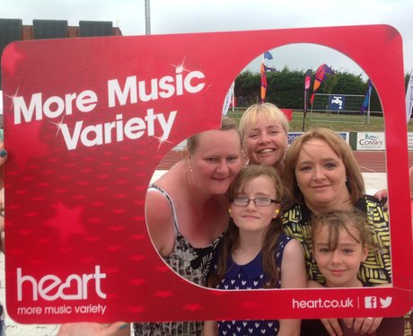 Listeners posing with Heart frame at Jessie J gig