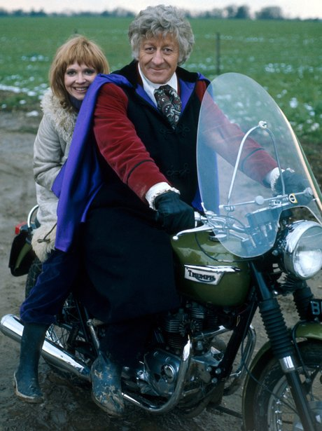 Jon Pertwee as The Doctor and Katy Manning on a motorbike