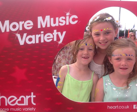 Little girls pose with the Heart frame