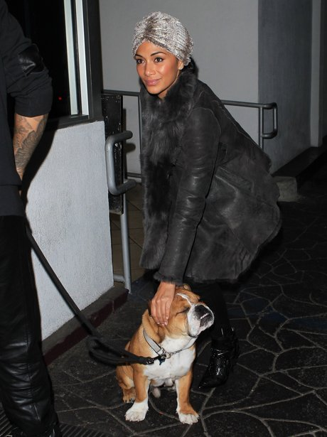 Nicole Scherzinger patting her pet bulldog