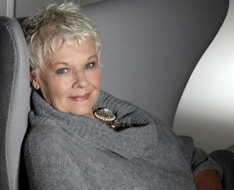 Judi Dench in a grey coat