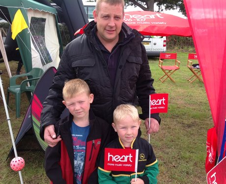 Family pose with Heart flags by their stand.