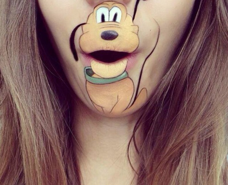 Laura Jenkinson with Pluto painted on her face