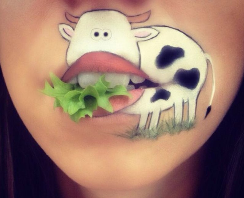 Laura Jenkinson with a cow painted painted her face