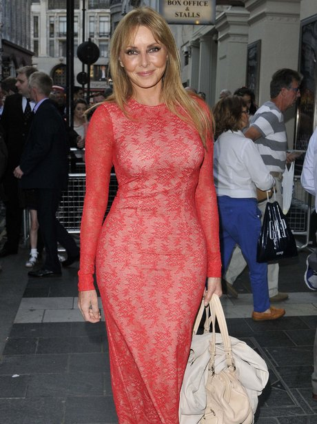 Carol Vorderman in a red lace dress.