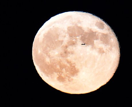 Plane flying past the Super moon September 2014