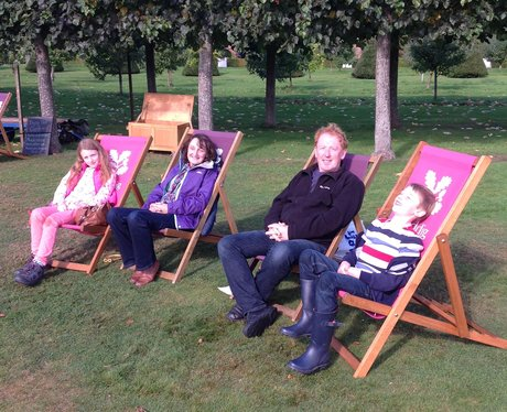 family on deckchairs