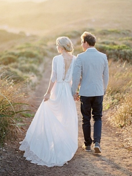A couple walking in a field