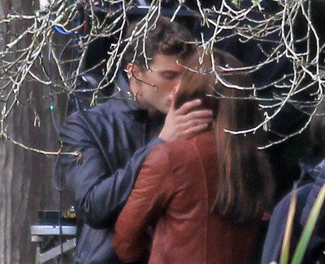 Jamie Dornan and Dakota Johnson on set kiss