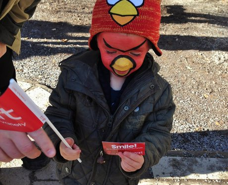 Little boy with Angry Bird face paint and hat