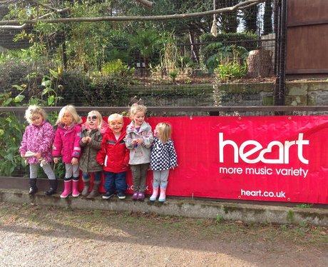 children in front of banner