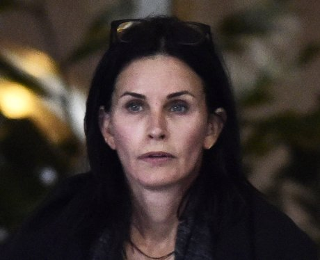 Courteney Cox wearing no make up with her dogs