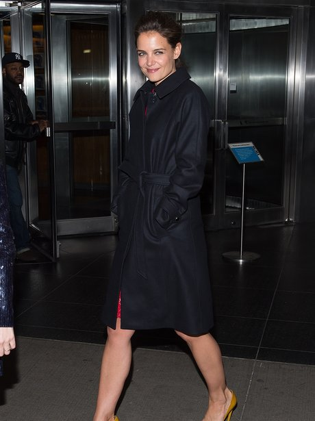 Katie Holmes wears a dark trench coat
