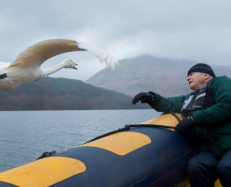 David Attenborough in a boat