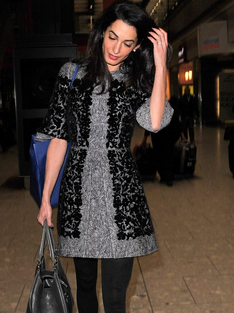 Amal Alamuddin Clooney shows off her wedding ring