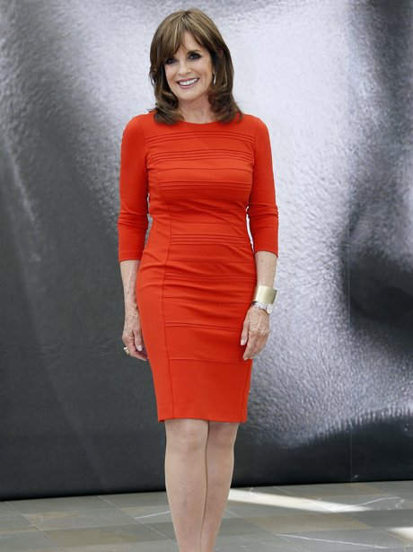 linda gray in a red dress
