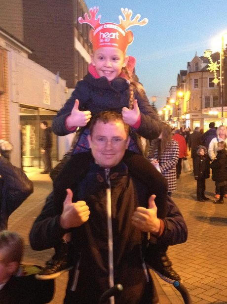 little girl on dads shoulders
