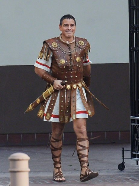 George Clooney on set in costume