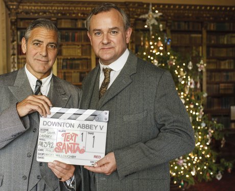 George Clooney with Hugh Bonneville on set