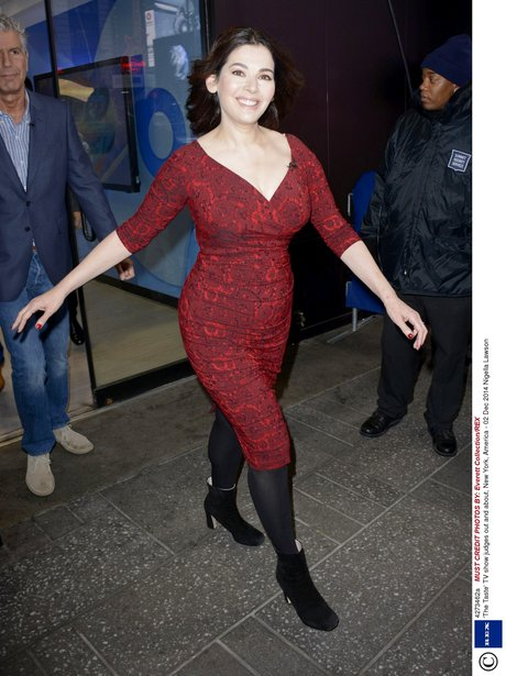 Nigella Lawson in a tight red mini dress