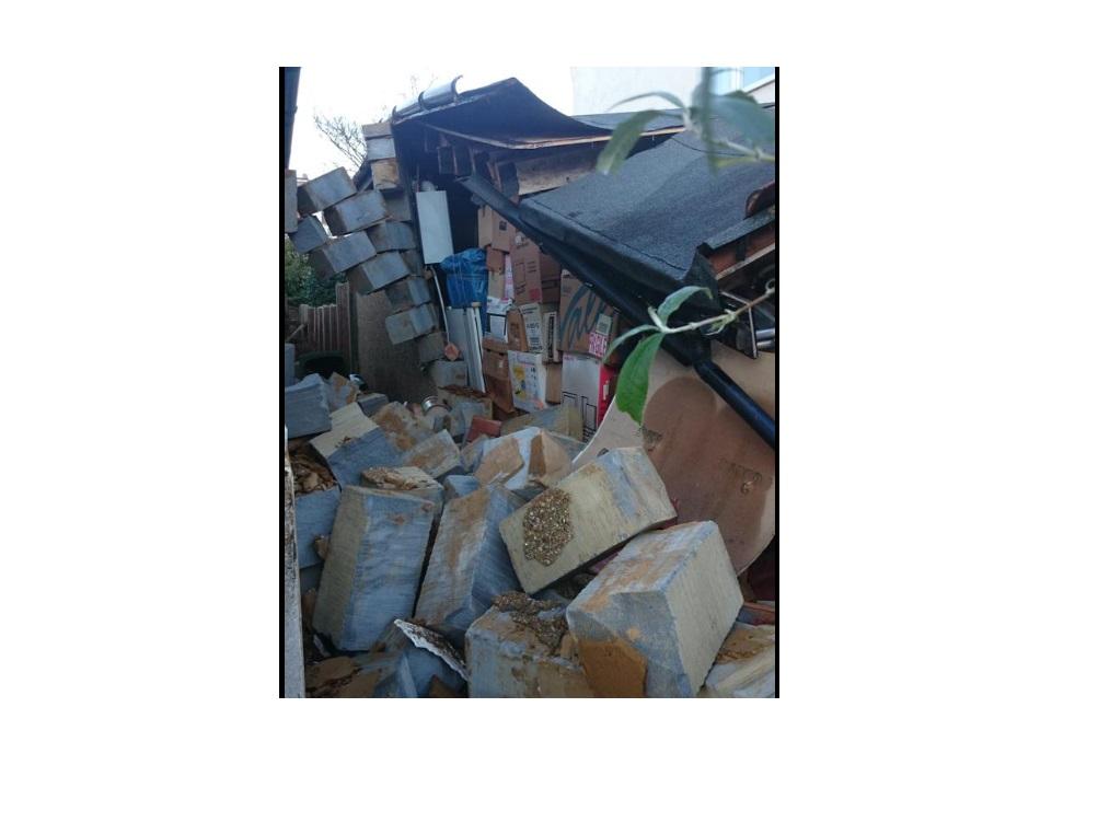Garage damaged by Harrow mini tornado