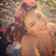 Image 7: Kelly Brook wears flowers on the beach