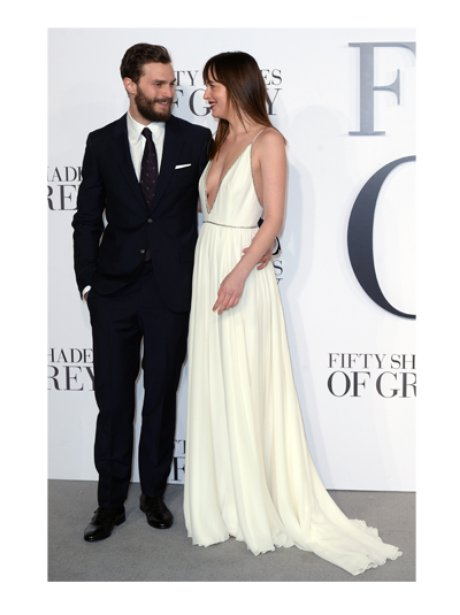 Dakota Johnson and Jamie Dornan on the grey carpet