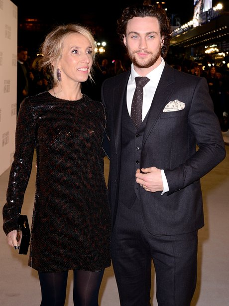 Sam Taylor Wood and Aaron Johnson on the grey carpet