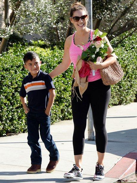 Kelly Brook handed flowers by young fan in LA