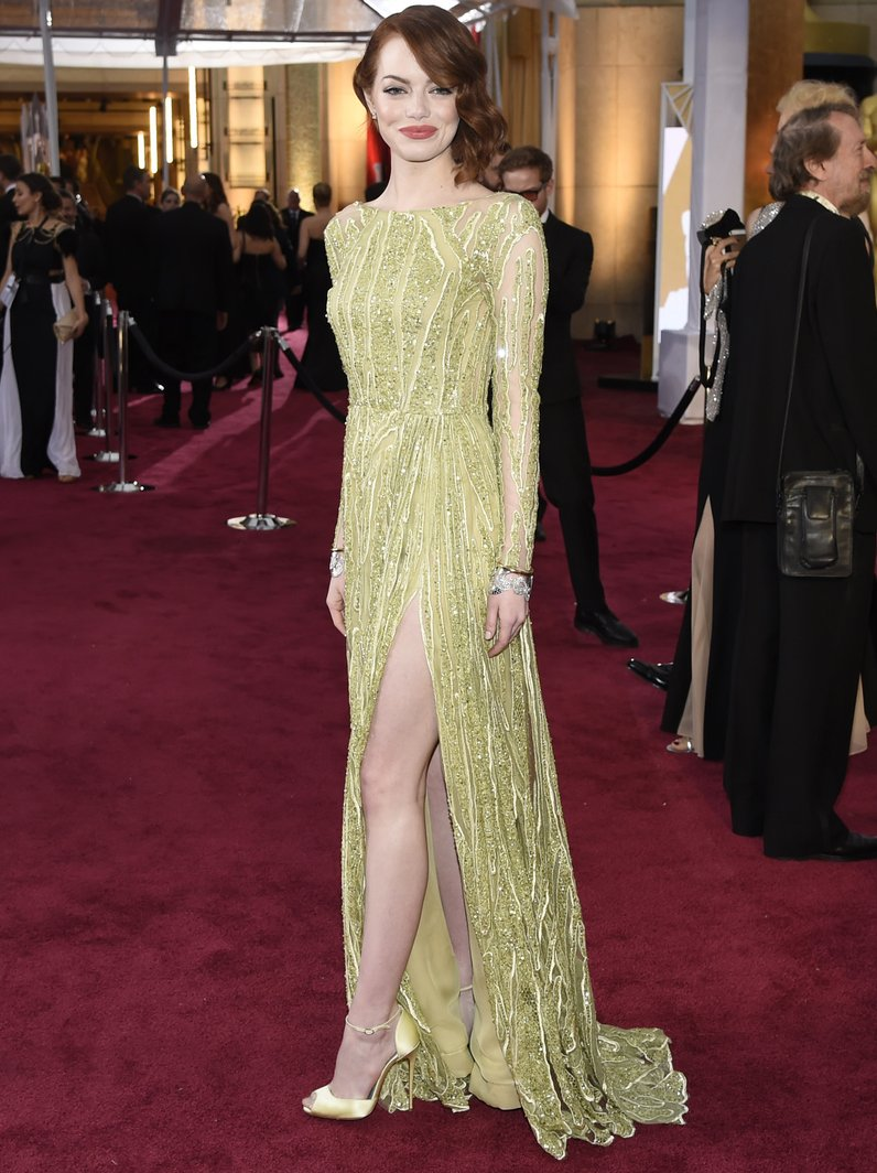Emma Stone arrives at the Oscars 2015