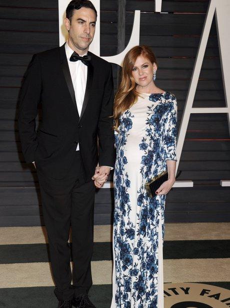 Isla Fisher and Sacha Baron Cohen at the Oscars Va