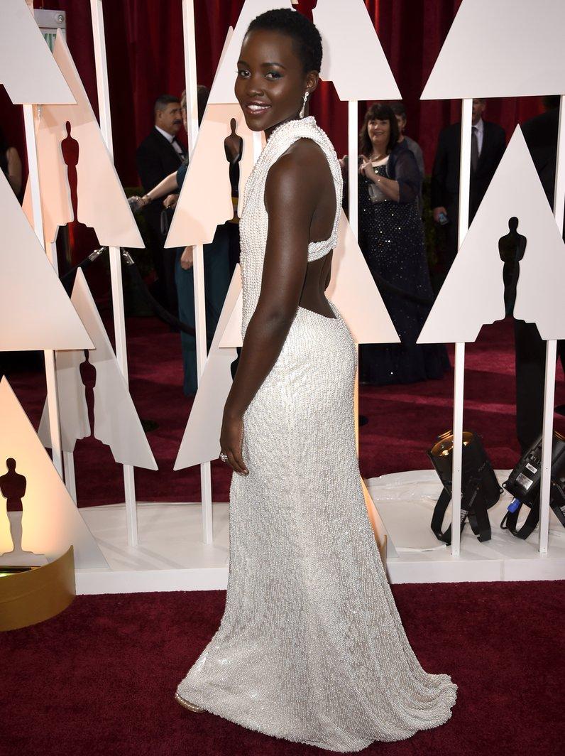 Lupita Nyong'o calvin klein dress at Oscars 2015