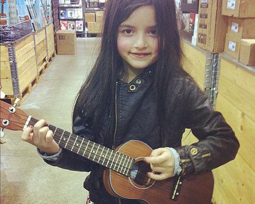 Angelina Jordan with a guitar at 5-years-old