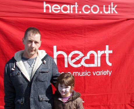 dad and daughter outside heart tent