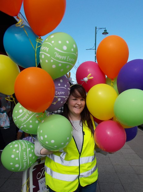 steward covered in balloons