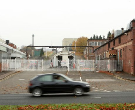 Rover car drives past closed Longbridge site