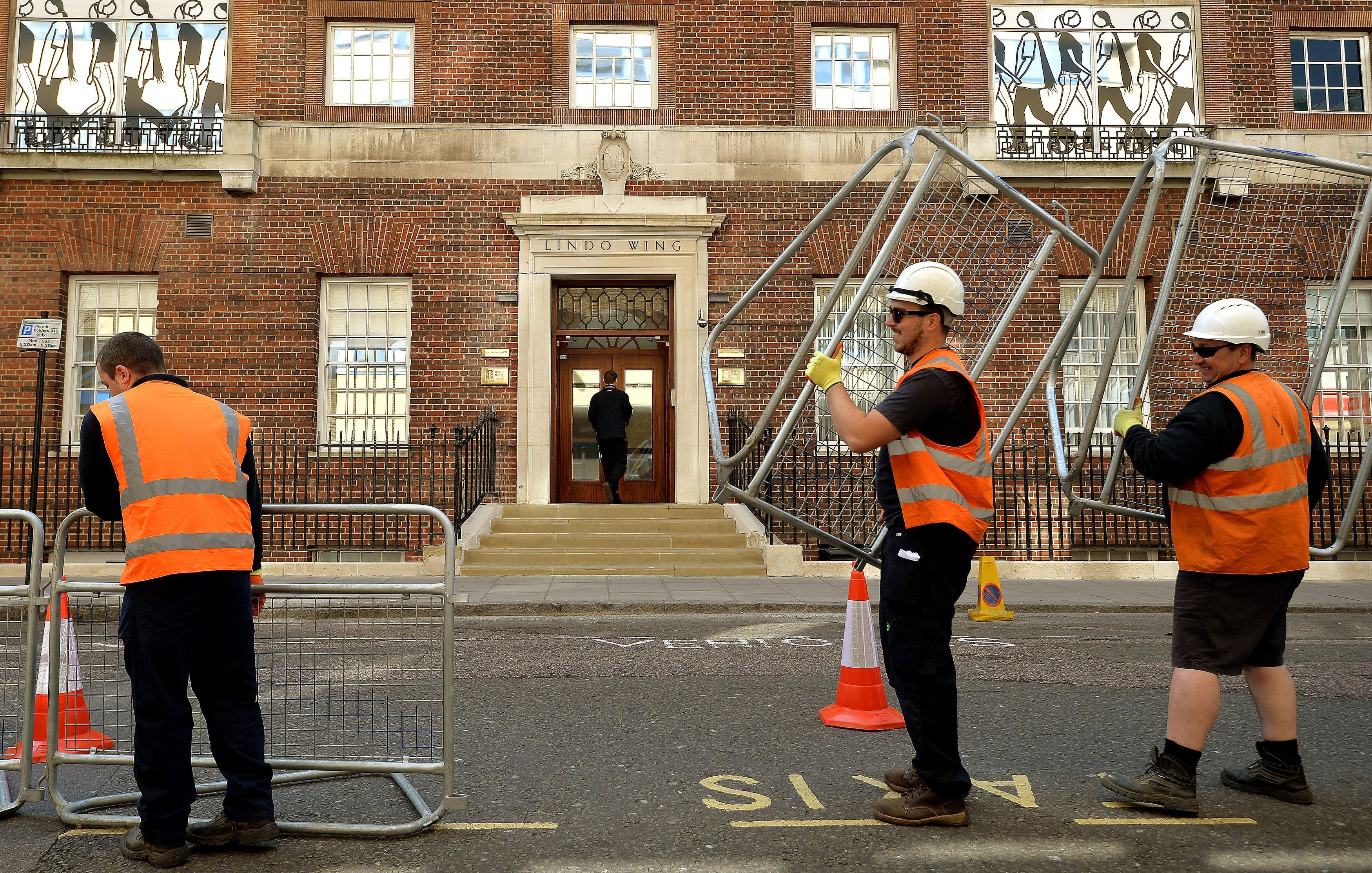 Men set up barriers for the second royal baby
