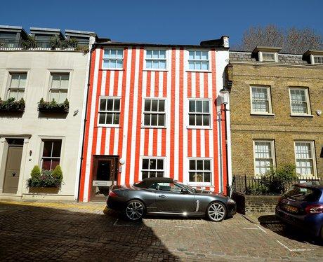 Stripy house on a posh street