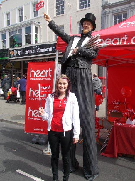 heart angel with man on stilts